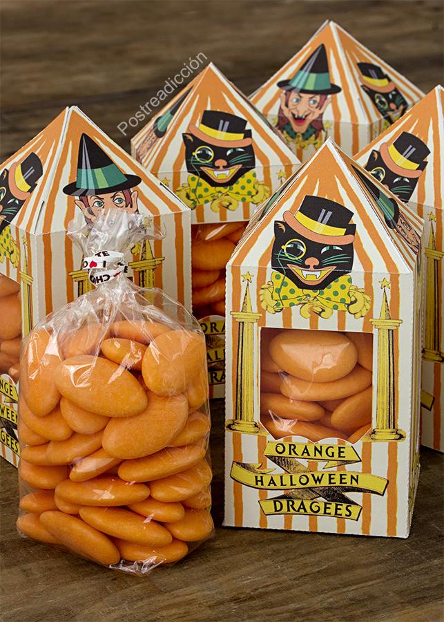 Imagen de producto: https://tienda.postreadiccion.com/img/articulos/secundarias12146-1-kg-de-grageas-naranjas-rellenas-de-chocolate-3.jpg