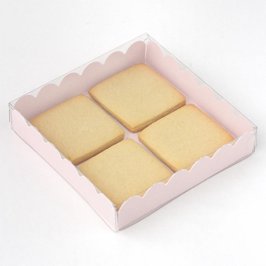 Imagen de producto: https://tienda.postreadiccion.com/img/articulos/secundarias12856-caja-de-carton-rosa-claro-cuadrada-1.jpg