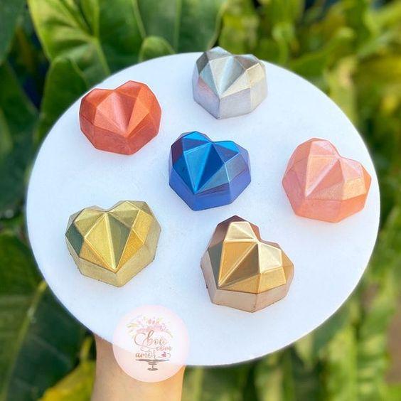 Imagen de producto: https://tienda.postreadiccion.com/img/articulos/secundarias14030-molde-3-portoformas-corazones-pequenos-geometricos-10.jpg