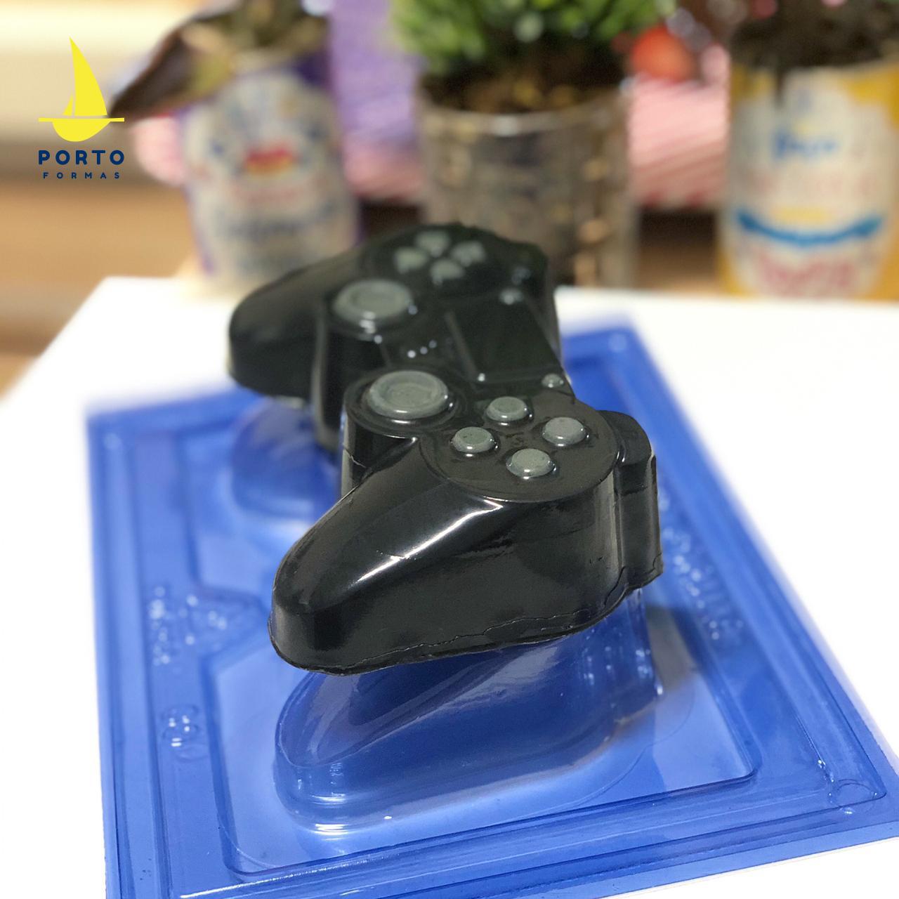 Imagen de producto: https://tienda.postreadiccion.com/img/articulos/secundarias14038-molde-69-portoformas-mando-consola-2.jpeg